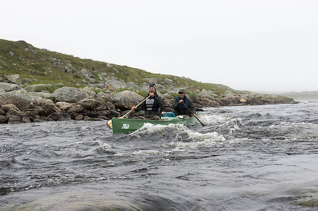 Morten and Paul paddling a rapid in the canoe.