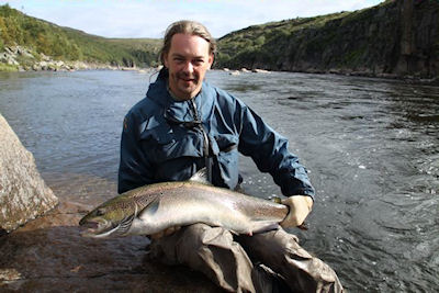 Jan with a 20lb Fish caught and 12 year old Vladimir with his first ever salmon click on image to enlarge