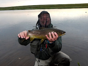Edvard with his first fish, a fat 1.7 kg trout - click on image to enlarge