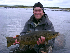 Tobi with a nice trout at SWAN,64cm,3,3 kg!
