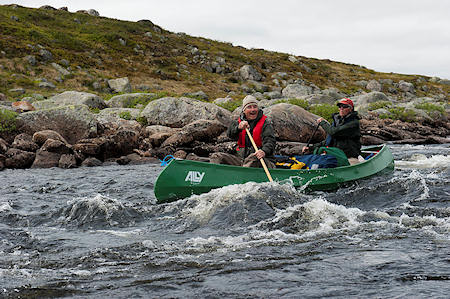 Pal and Morten paddling through rapids with full control