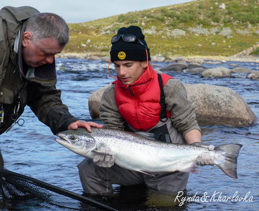 Mikhail with his guide Jenya at Zolotaya river ready to relise his salmon