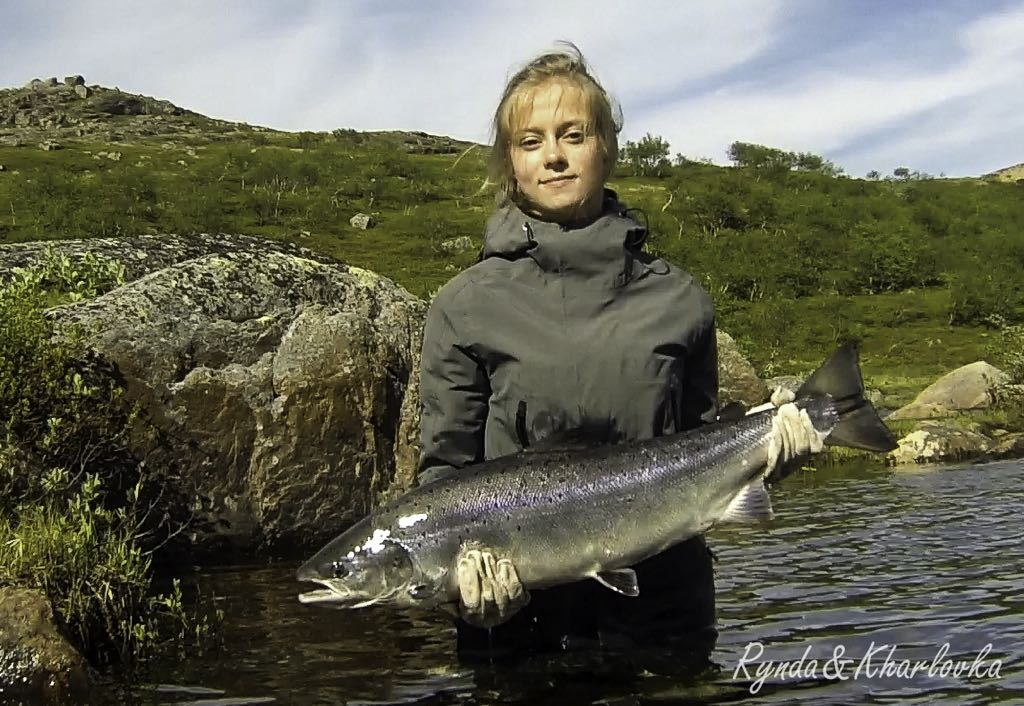 Valeriya from Murmansk with her 13 ponder from Rock Isl_ fished first time with a fly rod_She was very intusiastic and keen neophyte